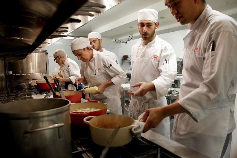 Chef-instructor Catherine Pantsois works with students in the kitchen